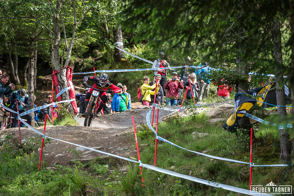 Faustin Figaret steps on the gas during his race run at the UCI Mountain Bike World Cup in Fort William.