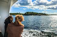 Båt passagerare med passbåt till Arholma i Stockholms skärgård. / Stockholms archipelago Sweden.
