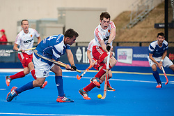 England's Henry Weir takes evasive action from Willie Marshall's shot during England v Scotland - Investec London Cup, Lee Valley Hockey & Tenis Centre, London, UK on 09 July 2014. Photo: Simon Parker