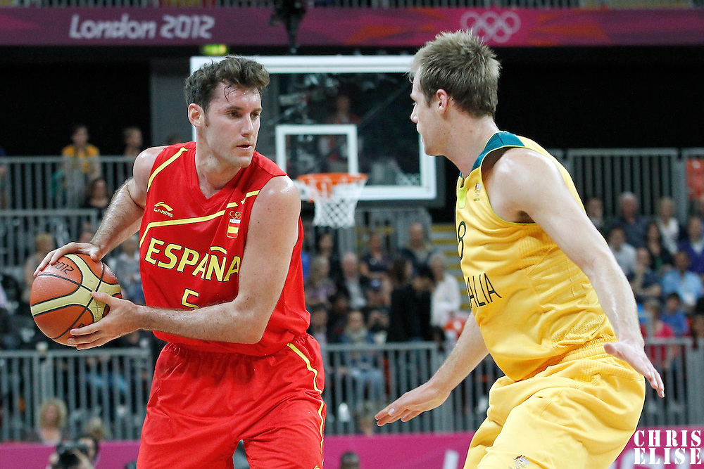31 July 2012: Spain Rudy Fernandez looks to pass the ball over Australia Brad Newley during the 82-70 Spain victory over Australia, during the men's basketball preliminary, at the Basketball Arena, in London, Great Britain.
