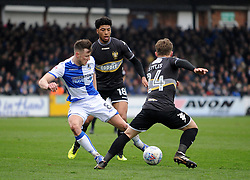 Ollie Clarke of Bristol Rovers is challenged by Josh Laurent and Callum Styles of Bury - Mandatory by-line: Neil Brookman/JMP - 30/03/2018 - FOOTBALL - Memorial Stadium - Bristol, England - Bristol Rovers v Bury - Sky Bet League One