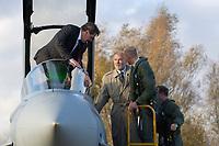 """03 NOV 2003, LAAGE/GERMANY:<br /> Gerhard Schroeder (L), SPD, Bundeskanzler, klettert aus dem Cockpit eines Eurofighter EF 2000 """"Typhoon"""", hier in der zweisitzigen Ausbildungsversion, dem neuen Jagdflugzeug der Bundesluftwaffe, im Rahmen eines Besuches der Luftwaffe, Mitte: Harald Ringstorff, SPD, Ministerpraesident Mecklenburg-Vorpommern, Rechts: Piloten, Jagdgeschwader 73 """"Steinhoff"""", Fliegerhorst Laage<br /> IMAGE: 20031103-01-047<br /> KEYWORDS: Bundeswehr, Bundesluftwaffe, Jet, Kampfflugzueg, Gerhard Schröder"""