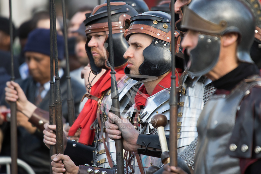Trafalgar Square, London, March 25th 2016. Thousands of Londoners an tourists in Trafalgar Square are treated to The Passion of Jesus, a re-enactment of the events leading up to the crucifixion and resurrection of Jesus Christ. PICTURED: Roman soldiers watch the trial of Jesus. <br /> ©Paul Davey<br /> FOR LICENCING CONTACT: Paul Davey +44 (0) 7966 016 296 paul@pauldaveycreative.co.uk