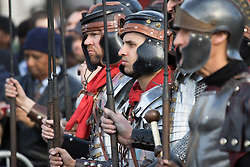 Trafalgar Square, London, March 25th 2016. Thousands of Londoners an tourists in Trafalgar Square are treated to The Passion of Jesus, a re-enactment of the events leading up to the crucifixion and resurrection of Jesus Christ. PICTURED: Roman soldiers watch the trial of Jesus. <br /> &copy;Paul Davey<br /> FOR LICENCING CONTACT: Paul Davey +44 (0) 7966 016 296 paul@pauldaveycreative.co.uk