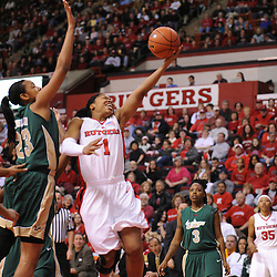 Jan 31, 2009; Piscataway, NJ, USA; Rutgers guard Khadijah Rushdan (1) puts in a layup under South Florida center Jessica Lawson (23) during the first half of South Florida's 59-56 victory over Rutgers in NCAA women's college basketball at the Louis Brown Athletic Center