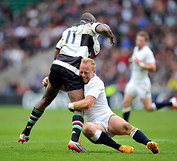 Shane Geraghty of England tackles Ugo Monye (Harlequins/England) of the Barbarians - Photo mandatory by-line: Patrick Khachfe/JMP - Mobile: 07966 386802 31/05/2015 - SPORT - RUGBY UNION - London - Twickenham Stadium - England XV v Barbarians - International Rugby