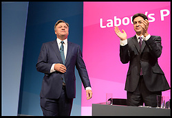 Image ©Licensed to i-Images Picture Agency. 22/09/2014. Manchester, United Kingdom. Leader of the Labour Party  Ed Miliband congratulates Shadow Chancellor of the Exchequer Ed Balls after he deliving his conference  Speech to the 2014 Labour Party Conference in Manchester. Picture by Andrew Parsons / i-Images
