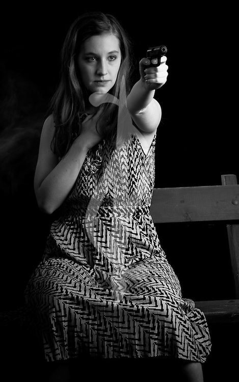 Female model in a retro outfit on a bench.