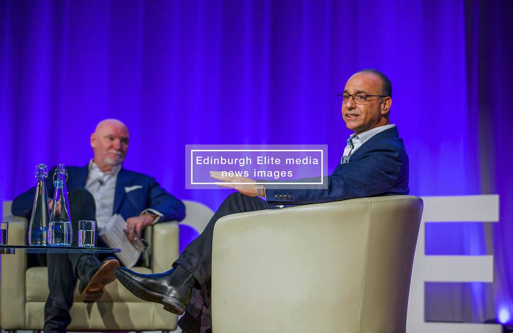 Theo Paphitis of BBC's Dragons' Den, right, in conversation with entrepreneur Sir Tom Hunter at the Scottish Edge startup finals held at RBS HQ, Gogarburn, Edinburgh. Pic: Terry Murden @edinburghelitemedia