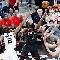01 May 2017: Houston Rockets guard James Harden (13) goes for the layup past San Antonio Spurs forward Kawhi Leonard (2) during the Houston Rockets 126-99 victory over the San Antonio Spurs, in game 1 of the Western Conference Semi Finals, at the AT&T Center, San Antonio, Texas, USA.