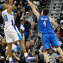 January 24,  2011; New Orleans, LA, USA; New Orleans Hornets power forward David West (30) shoots over Oklahoma City Thunder power forward Nick Collison (4) during the fourth quarter at the New Orleans Arena. The Hornets defeated the Thunder 91-89. Mandatory Credit: Derick E. Hingle