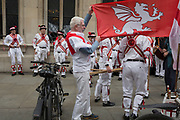 Morris Men dance on St George's Day on Liverpool Street in the capital's financial district (aka The Square Mile), on 23rd April, City of London, England.
