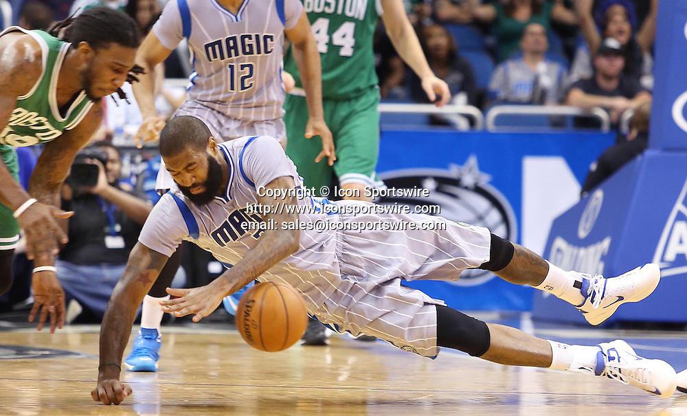 Dec. 23, 2014 - Orlando, FL, USA - The Orlando Magic's Kyle O'Quinn (2) dives for a loose ball against the Boston Celtics at the Amway Center in Orlando, Fla., on Tuesday, Dec. 23, 2014. The Magic won, 100-95