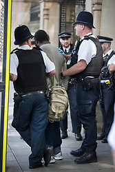 © Licensed to London News Pictures. 22/06/2017. London, UK. Police hold a man who earlier was tasered near an entrance to Parliament. Photo credit: Peter Macdiarmid/LNP
