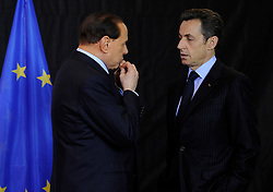 Silvio Berlusconi, Italy's prime minister, left, speaks with Nicolas Sarkozy, France's president, during the European Union summit at EU headquarters in Brussels, Belgium, on Sunday, March. 1, 2009. .(Photo © Jock Fistick).