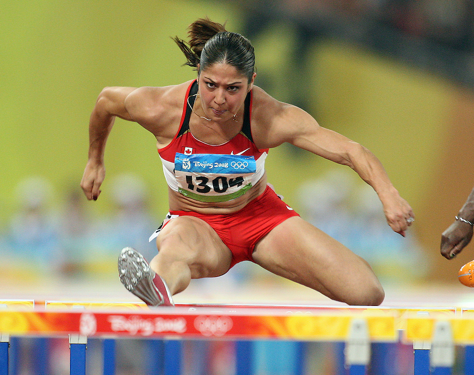 2008 Beijing Olympic Games- Day 3 - August 17th- Evening. Photo: Claus Andersen *** Priscilla Lopes -- 100m hurdles, Canada *** August 17