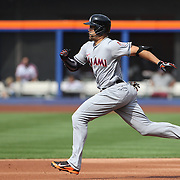 NEW YORK, NEW YORK - July 05: Giancarlo Stanton #27 of the Miami Marlins runs to second base on a hit during  the Miami Marlins Vs New York Mets regular season MLB game at Citi Field on July 04, 2016 in New York City. (Photo by Tim Clayton/Corbis via Getty Images)