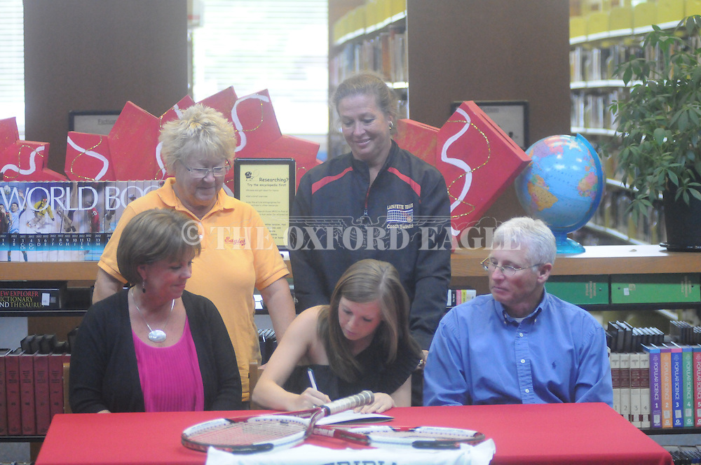 Lafayette High tennis player Mallory Davis signs to play with Meridian Community College, in Oxford, Miss. on Monday, April 16, 2012.