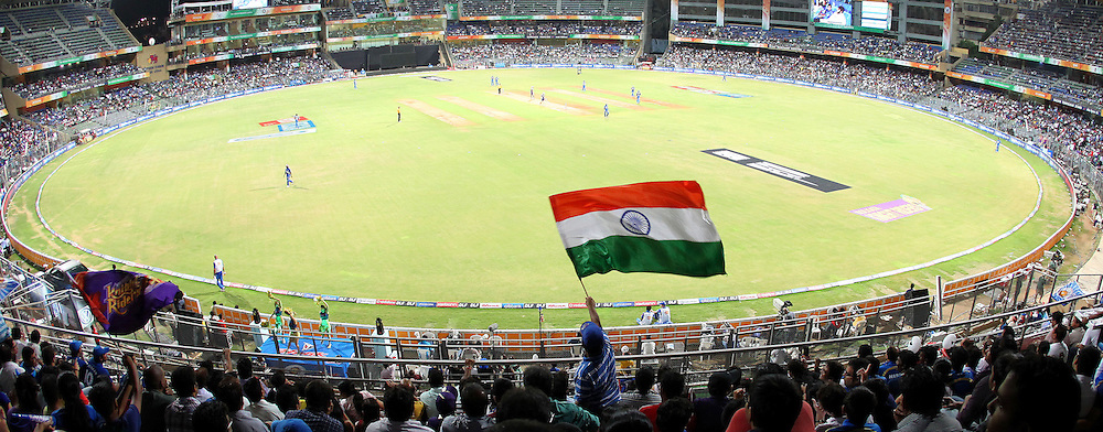 A fan waves the Indian flag during the IPL Season 4 eliminator match of the Indian Premier League between the Mumbai Indians and the Kolkata Knight Riders held at the Wankhede Stadium, Mumbai, India on the 25th May 2011..Photo by Ron Gaunt/BCCI/SPORTZPICS.