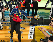 Joey Logano took the checkered flag and the million dollars at the NASCAR Sprint All-Star Race.