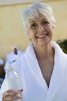 Portrait of senior woman in bathrobe at health spa