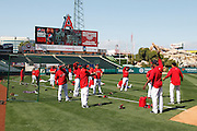 ANAHEIM, CA - APRIL  23:  Members of the Los Angeles Angels of Anaheim stretch before the game between the Boston Red Sox and the Los Angeles Angels of Anaheim on Saturday, April 23, 2011 at Angel Stadium in Anaheim, California. The Red Sox won the game in a 5-0 shutout. (Photo by Paul Spinelli/MLB Photos via Getty Images)