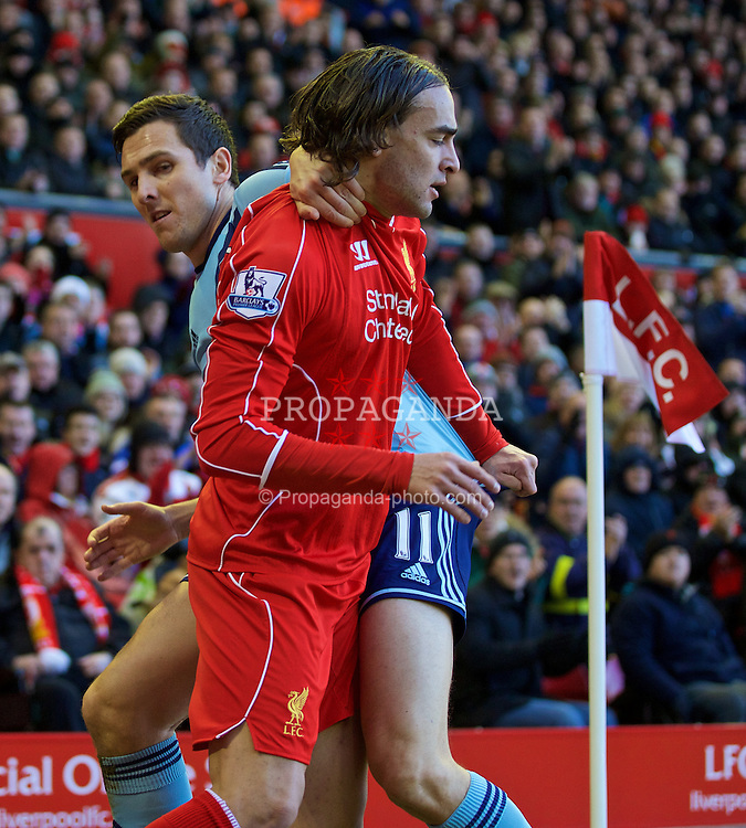 LIVERPOOL, ENGLAND - Saturday, January 31, 2015: Liverpool's Lazar Markovic clashes with West Ham United's Stewart Downing during the Premier League match at Anfield. (Pic by David Rawcliffe/Propaganda)