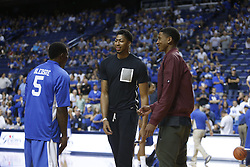 Kentucky head coach Anthony Davis, center, talks with Kentucky Alum Eric Bledsoe, left, and newcomer Charles Matthews, before the game. The Kentucky Alumni Men's Basketball team hosted the University of North Carolina Alumni in a charity game, Sunday, Sept. 13, 2015 at Rupp Arena in Lexington. <br /> <br /> Photo by Jonathan Palmer