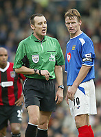 SBI/PHOTOGRAPHER HARRY HERD.         PORTSMOUTH 4 V MAN CITY 2. PORTSMOUTH CAPTAIN TEDDY SHERINGHAM GETS AN EAR BLASTING FROM REFEREE MR. M. MESSIAS AGAINST MAN CITY IN THE BARCLAYCARD PREMIERSHIP MATCH AT FRATTON PARK.<br />