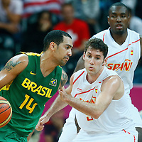 06 August 2012: Brazil Marquinhos Vieira Sousa drives past Spain Rudy Fernandez during 88-82 Team Brazil victory over Team Spain, during the men's basketball preliminary, at the Basketball Arena, in London, Great Britain.