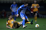 Jake Carroll of Cambridge United and Nathan Thomas of Hartlepool United in action during the EFL Sky Bet League 2 match between Cambridge United and Hartlepool United at the Cambs Glass Stadium, Cambridge, England on 14 March 2017. Photo by Harry Hubbard.
