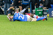 Joe Ward (23) goes down injured during the EFL Sky Bet League 1 match between Peterborough United and Rotherham United at London Road, Peterborough, England on 25 January 2020.
