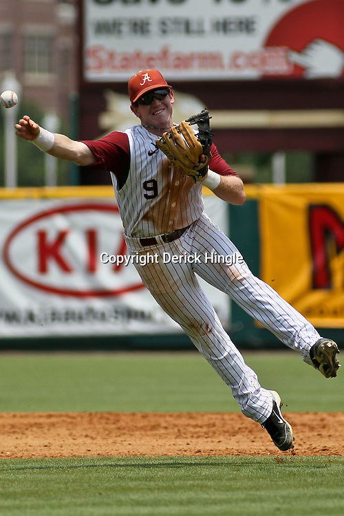 June 05, 2011; Tallahassee, FL, USA; Alabama Crimson Tide short stop Jared Reaves (9) throws to first during the fourth inning of the Tallahassee regional of the 2011 NCAA baseball tournament against the UCF Knights at Dick Howser Stadium. Alabama defeated UCF 12-5. Mandatory Credit: Derick E. Hingle