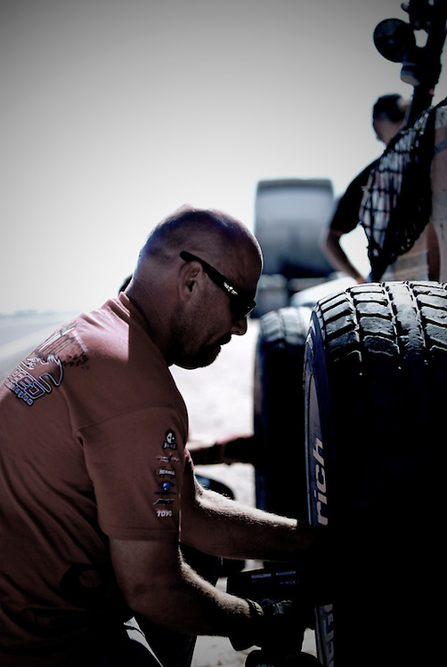Crew Chief, JT Taylor of Speed Technologies, completes a tire change during the 2007 Baja 1000 for the team's HMS car.