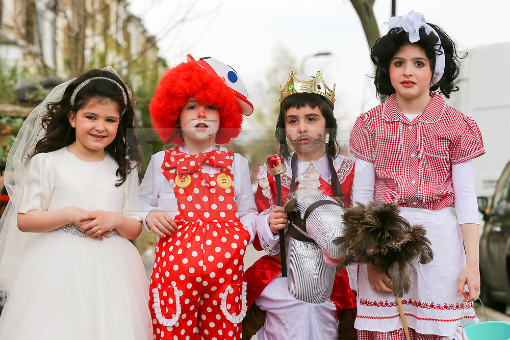 © Licensed to London News Pictures. 21/03/2019. London, UK. Orthodox Jewish children in fancy dress on the streets of Stamford Hill in north London celebrate the festival of Purim - one of the most entertaining Jewish holidays. It commemorates the time when the Jewish people living in Persia were saved from  massacre by Haman. It is customary to hold carnival-like celebrations on Purim, and for groups of men to go round visiting local wealthy men, collecting for their charity. <br /> <br /> Permission granted by the parents. <br /> <br /> Photo credit: Dinendra Haria/LNP