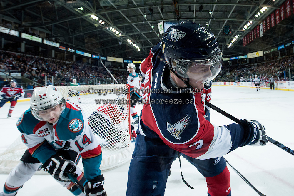 KELOWNA, CANADA - MARCH 27: Rourke Chartier #14 of Kelowna Rockets stick checks Riley Hillis #3 of Tri-City Americans behind the net on March 27, 2015 at Prospera Place in Kelowna, British Columbia, Canada.  (Photo by Marissa Baecker/Shoot the Breeze)  *** Local Caption *** Rourke Chartier; Riley Hillis;