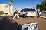26 SEPTEMBER 2010 - PHOENIX, AZ: Liz Hourican, from Phoenix, AZ, is stopped from approaching Sen. John McCain's car by Phoenix police during a demonstration against McCain Sunday. About 200 people demonstrated and picketed against Arizona Republican Senator John McCain at the studios of KTVK TV in Phoenix, Sunday, Sept 26. They picketed the TV station because McCain was debating his opponents there. They were demonstrating against McCain's positions on the war in Afghanistan, Don't Ask Don't Tell (Gays in the military) and the DREAM Act (for immigrant rights). PHOTO BY JACK KURTZ