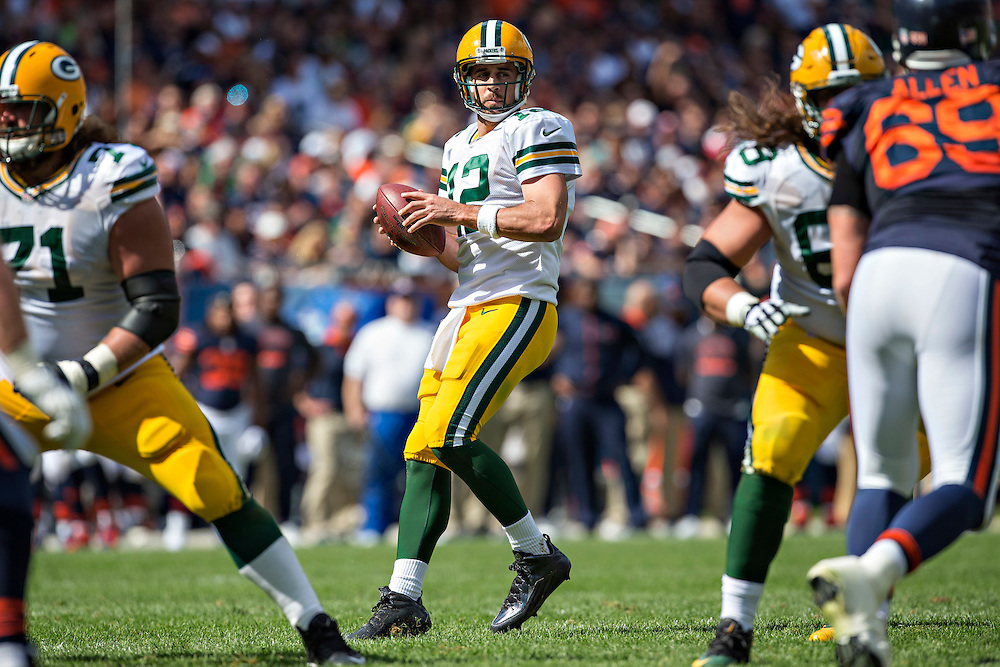 CHICAGO, IL - SEPTEMBER 13:  Aaron Rodgers #12 of the Green Bay Packers drops back to pass against the Chicago Bears at Soldier Field on September 13, 2015 in Chicago, Illinois.  The Packers defeated the Bears 31-23.  (Photo by Wesley Hitt/Getty Images) *** Local Caption *** Aaron Rodgers