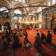 A tour group sits with its guide in Istanbul's Rustem Pasha Mosque near the Spice (Egyption) Market.