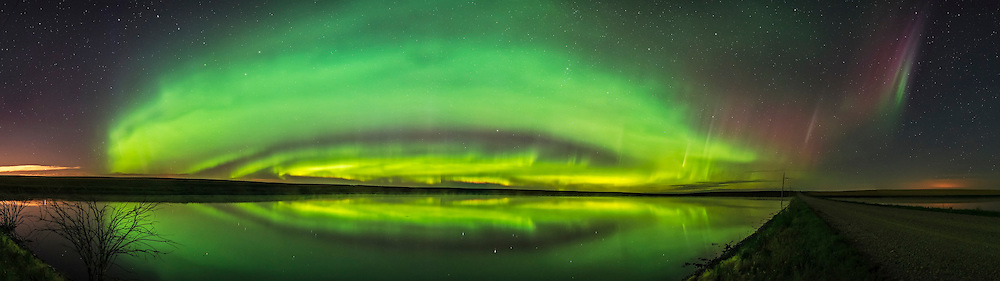 A 180&deg; panorama of the Northern Lights exhibiting classic concentric ars across the north, with an isolated arc to the east at far right. It extended up across the sky overhead and had a faint arc to the west as well, not seen here. This shows how a typical aurora display is made of nested arcs created by incoming electrons raining down the magnetic field lines in concentric arcs. Often, an isolated arc far to the south of the main group forms, and often appears red, though can have normal green components as well, as here. Is this a &ldquo;proton arc?&rdquo; It would seem this is a normal electron-induced aurora but clearly with a slightly different origin in the source region for the electrons. <br /> <br /> The most northerly and distant curtains exhibit a slight tint of pink on the lower fringes, from nitrogen glowing.<br /> <br /> This was the night of September 2, 2016, from near home in southern Alberta. The Big Dipper is at upper left. The bright star reflected is Capella. Perseus and Andromeda are right of centre.<br /> <br /> This is a stitch of 10 segments, each 2-second exposures with the 20mm Sigma Art lens at f/1.6 and Nikon D750 at ISO 3200. Stitched with PTGui.