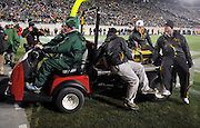 Oct 24, 2009; East Lansing, MI, USA; Medical staff drive Iowa tight end Kyle Spading (30) off the field during the fourth quarter against Michigan State Spartans at Spartan Stadium. The Hawkeyes beat the Spartans 15-13. Mandatory Credit: Jason Miller-US PRESSWIRE
