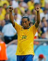 Photo: Glyn Thomas.<br /> Brazil v Australia. Group F, FIFA World Cup 2006. 18/06/2006.<br /> <br /> Brazil's Ronaldinho celebrates his team's 2-0 win.