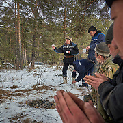 "Kim Pomishin, a shaman at a Buryati village in Selenga in the Kabansk region along the shore at Russia's Lake Baikal, uses vodka to perform a ritual. He does the ritual on behalf of his brother who owns a tree logging company. They are asking for forgiveness from the trees. Crowned the ""Jewel of Siberia"", Baikal is the world's deepest lake, and the biggest lake by volume, holding 20% of the world's fresh water. In the winter, the lake 31,722 square meter surface is entirely frozen with ice averaging 2 meters thick."