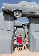Linda Woodland of Sterling, Massachusetts, views the eclipse with her son Diego at Carhenge on Monday, Aug. 21, 2017, in Alliance, Nebraska.<br /> <br /> MATT DIXON/THE WORLD-HERALD