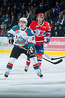 KELOWNA, CANADA - JANUARY 16:  Cole Martin #8 of the Kelowna Rockets is checked by Liam Stewart #11 of the Spokane Chiefs at the Kelowna Rockets on January 16, 2013 at Prospera Place in Kelowna, British Columbia, Canada (Photo by Marissa Baecker/Shoot the Breeze) *** Local Caption ***