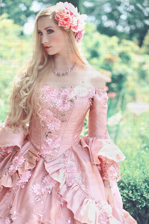 A beautiful young princess in her late teens stares off into the distance in a fantasy garden, wearing a fancy pink ballgown and flowers in her long blond hair