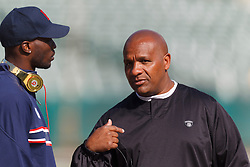 Oct 2, 2011; Oakland, CA, USA; Oakland Raiders head coach Hue Jackson (right) talks to New England Patriots wide receiver Chad Ochocinco (left) before the game at O.co Coliseum. Mandatory Credit: Jason O. Watson-US PRESSWIRE