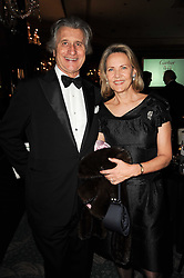 ARNAUD BAMBERGER Executive Chairman of Cartier UK and his wife CARLA at the 20th annual Cartier Racing Awards - the most prestigious award ceremony within European horseracing, held at The Dorchester Hotel, Park Lane, London on 16th November 2010.
