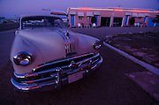 The Mother Road: Historic Route 66 – a vintage 1951 Pontiac Chieftain sits parked in front of the Blue Swallow Motel in Tucumcari, New Mexico.