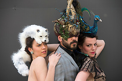 The Animal Ball..This years Animal Ball which brings the glamour and splendour of a masked soiree to the heart of London will benefit the charity Elephant Family with masks created by the likes of Christian Lacroix, Mario Testino and Swarovski. Pic Shows Natalie Ellner wearing her creation Lady Peacock, Chris Jones wearing 'The Horned Mask' by natalie Ellner Lucy Franks wearing a creation by Natalie Ellner 'Snow Fox. The masks will be on show at Sotheby's until May 15th, London, UK, May 10, 2013. Photo by:  i-Images